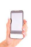 Main retenant le téléphone intelligent Images libres de droits