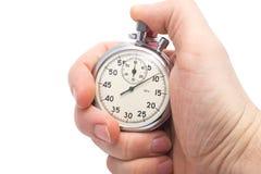 main retenant le vieux chronomètre mécanique Images libres de droits