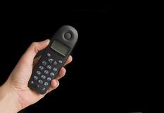 Main retenant un téléphone image stock