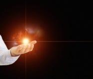 Main retenant une étoile avec la nébuleuse Photos libres de droits
