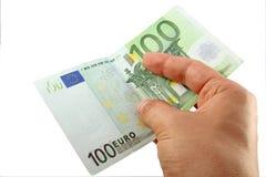 Main retenant une facture de l'euro 100 Images libres de droits