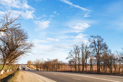 Main road in country district in early spring Royalty Free Stock Photos