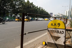 Main Road, Hyderabad. HYDERABAD, ANDHRA PRADESH, INDIA - JANUARY 8: Traffic travelling along National Highway number 9 through the centre of Hyderabad city on Royalty Free Stock Photos