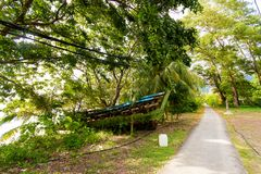 Main road on Tioman island. Main village road on tropical Tioman island in Malaysia. Beautiful nature of south east asia Royalty Free Stock Images