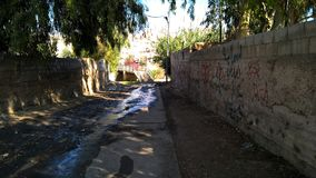 The main road to the pedestrian bridge. Under that bridge is the only zarqa river royalty free stock image