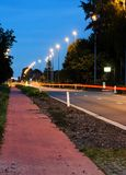 Main road in twilight. With car trails Royalty Free Stock Image