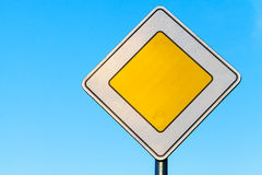 Main road yellow roadsign above blue sky background Stock Image
