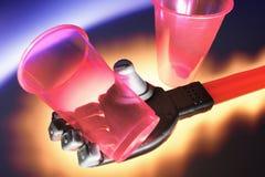 Main robotique avec les cuvettes en plastique Photos stock