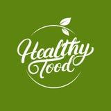 Main saine de nourriture écrite marquant avec des lettres le logo, le label, les insignes ou les emblèmes pour les produits frais Photos libres de droits