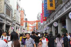 Booming economy in the main shopping area Shangxia Jiu Lu Pedestrian Street in Guangzhou, China. Main shopping area Shangxia Jiu Lu Pedestrian Street in the city Royalty Free Stock Images
