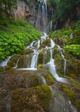 Main Sopotnica waterfall and many cascades at cloudy day. Beautiful waterfalls and cascades in woods at cloudy morning. Travel destination Sopotnica, Serbia Stock Image