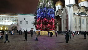 The main spruce Russia. MOSCOW, RUSSIA - DEC 27, 2014: People on the Cathedral Square of the Moscow Kremlin on the main Christmas spruce of Russia