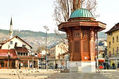 Main square in Sarajevo old town, Sebilj. Old Turkish funtain called Sebilj, in the center of Sarajevo old town Bascarsija. Also known as pigeon sqare by Stock Photo