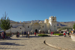 Main square and Church of the Immaculate Conception with mountai Royalty Free Stock Images