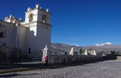 Main square and Church of the Immaculate Conception with mountains behind in Yanque, Colca Canyon, Peru. It was built in stock photos