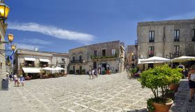 Main square of Erice with touristic shops and restaurants, near Trapani, Sicily, Italy. ERICE, ITALY - AUGUST 08, 2017: Main square of Erice with touristic shops royalty free stock image