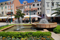 Main square with fountain in Mali Losinj,Croatia Royalty Free Stock Photos