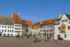 Main square in Freiberg, Germany. Historic houses and fountain with statue of the town founder on main square in Freiberg, Saxony,Germany Stock Photos