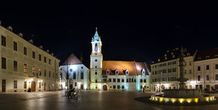 The Main Square & x28;Hlavne namestie& x29; and old Town Hall in the night, Bratislava, Slovakia. The square is located in the Old Town in the center of the Stock Photos