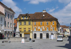 Main square in Kranj, Slovenia. Main square in medieval town of Kranj, Slovenia with colorful buildings at sunny sammer day Royalty Free Stock Photography