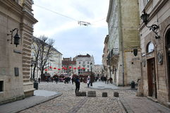 Main square of Lviv, street, passers, medieval architecture Stock Images