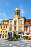 The main square of the medieval city of Brasov, main touristic city of Transylvania, Romania. Stock Photo