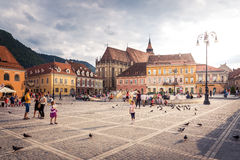 The main square of the medieval city of Brasov, Romania. October 10nd, 2015. Black Church in the middle background Royalty Free Stock Photo