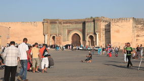 Main Square in Meknes, Morocco. Crowded main square Place Lahdim and Bab El-Mansour gate in Meknes, Morocco, North Africa stock footage