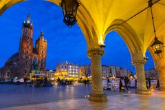 The main square of the Old Town in Krakow at dusk. KRAKOW, POLAND - NOVEMBER 12, 2017: The main square of the Old Town in Krakow at dusk, Poland. Krakow is the Stock Image
