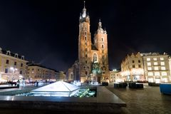 Main square and St. Mary`s Basilica in Krakow, Poland royalty free stock images
