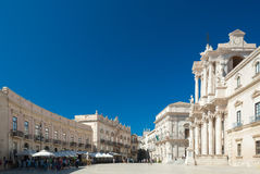 The main square of Syracuse. Piazza Duomo is the main baroque square of Syracuse, in Sicily. The church on the right is dedicated to St. Lucia Stock Photography