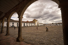 The main square of Villa de Leyva Colombia. July 17, 2017 Villa de Leyva, Colombia: the main square paved with cobblestone is one of the largest in South America Stock Photos