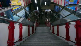 Main stair and  escalators in Siam station with BTS sky train passenger. The biggest transit jun stock video footage