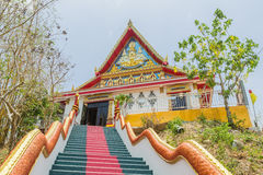 The main stair leading to  the replica of Phra That In-Kwaen (Hanging Golden Rock) at Sirey temple, Phuket, Thailand. Royalty Free Stock Photos