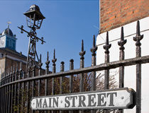 Main street. Small village sign on old victorian railings saying main street Stock Photography