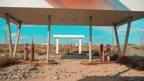Main street of america. Route 66. crisis road 66 fueling broken window slow motion video. Old dirty deserted gas station. U.S. closed supermarket store shop stock video footage