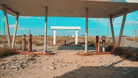 Main street of america. Route 66. crisis road 66 fueling broken window slow motion video. Old dirty deserted gas station. U.S. closed supermarket store shop stock footage