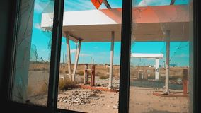 Main street of america. Route 66. crisis road 66 fueling broken window slow motion video. Old dirty deserted gas station. U.S. closed supermarket store shop stock video