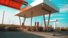 Main street of america. Route 66. crisis road 66 fueling slow motion video. Old dirty deserted gas station. U.S. closed. Supermarket store shop Abandoned gas stock footage