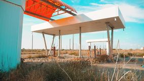 Main street of america. Route 66. crisis road 66 fueling slow motion video. Old dirty deserted gas station. U.S. closed. Supermarket store shop Abandoned gas stock video footage
