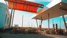 Main street of america. Route 66. crisis road 66 fueling slow motion video. Old dirty deserted gas station. U.S. closed. Supermarket store shop Abandoned stock video footage
