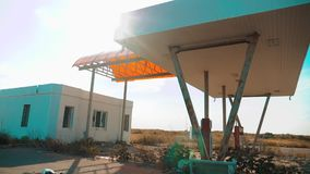 Main street of America. Route 66. Crisis road 66 fuelling slow motion video. Old dirty deserted gas station. lifestyle U. S. closed supermarket store shop stock footage