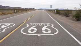 Main Street Of America Or The Sign Route 66 On The Highway. Shot movement the sign of the famous highway Route 66, painted on the highway asphalt , that runs stock video footage