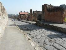 Main street at the ancient Roman city of Pompeii Stock Photos