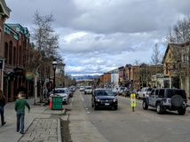 Main Street in Breckenridge Colorado. Cars and people on main street in Breckenridge Colorado stock images