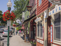 Main street in Camden, Maine, USA. Quaint, old fashioned central street in the coastal harbor town of Camden, Maine, USA Royalty Free Stock Image