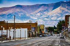 Main Street - Ely, Nevada. Route 50, the main street in western town of Ely, Nevada is seen against backdrop of mountain range. Ely was founded as a stagecoach royalty free stock photo