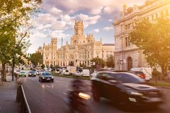 Main street in Madrid - Cybele Palace. Palacio de Cibeles - Madrid, Espania. Sunset on busy street in Madrid, Spain Royalty Free Stock Images
