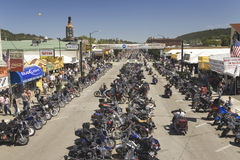 Main Street with motorcycles lining road Royalty Free Stock Image