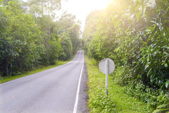 Main street in mountain tropical forest with traffic sign Stock Images